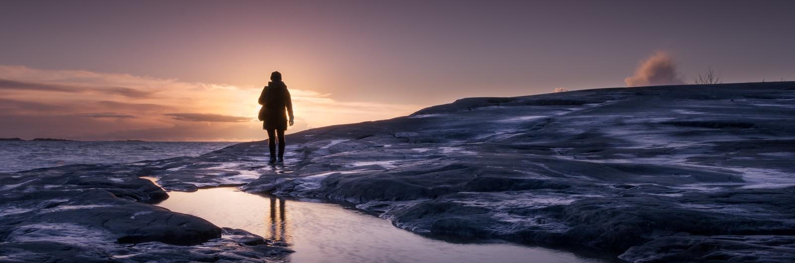 city header finland woman walking