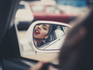 girl passenger mirror car