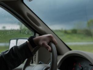 man driving rain